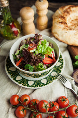 vegetable salad in Caucasian style with bread pita on wooden table