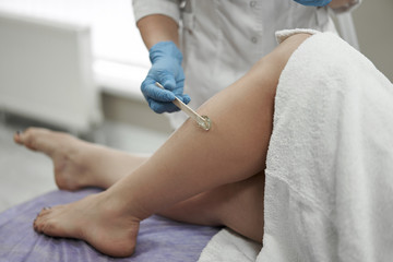 female feet on epilation in a beauty salon