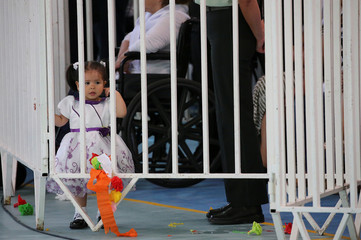 A daughter of a prisoner looks as Pope Francis visits the San Joaquin women's prison in Santiago