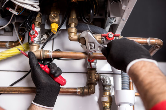 plumber fixing central heating system