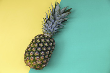 Top view of colorful fruit pattern of fresh pineapple on green and yellow background