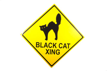 A black cat crossing sign for Halloween