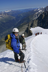 Climbers make their way along a ridge near the Aiguille du Midi on Mont Blanc Chamonix, France