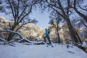 Man hiking in High Sierras in winter, California, USA