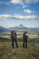 Rear view of people standing on Crowsnest Pass, Alberta, Canada