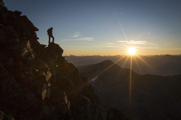 Silhouette of person standing on Mount Edith Cavell, Jasper, Alberta, Canada