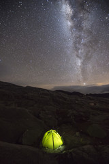 Tent under sky full of stars and milky way at camp in Sierra Nevada del Cocuy, Colombia