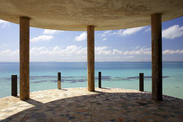 Terrace columns of abandoned coastal hotel against Indian Ocean, Mozambique