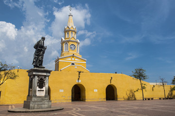 Clock Tower (Torre del Reloj) and main gate of old city wall in Cartagena, Bolivar, Colombia