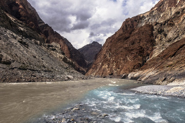 Turquoise stream feeding into Zanskar River, Ladakh Region, Jammu and Kashmir, India