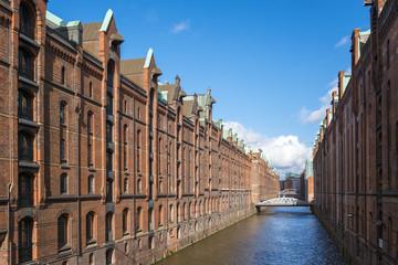 Historic warehouse buildings along Brooksfleet canal, in historic Speicherstadt quarter, UNESCO World Heritage Site, Hamburg, Germany