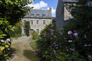 Path leading to big stone house, Treguier, Brittany, France