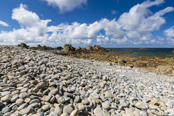 Sunny pebble beach in Brittany, France