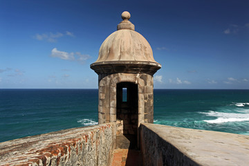 A Sentry Box of the El Morro Fortress in San Juan, Puerto Rico on a sunny Day with blue Sky and Sea