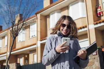 teenage girl student with smartphone