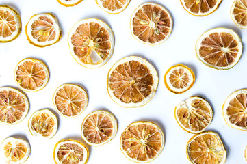 Dried sliced lemon background pattern isolated