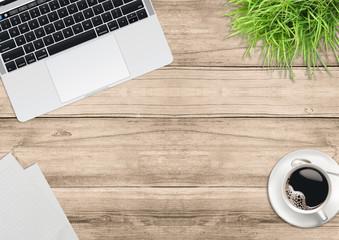Laptop computer, green plants, coffee on office wooden desk