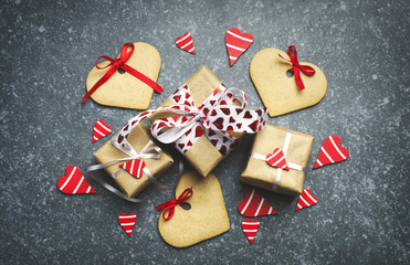 Gift box with decorative red hearts and heart shaped cookies.