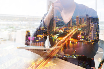 Double Exposure of Man or Male hold Digital Wireless Tablet with City Building