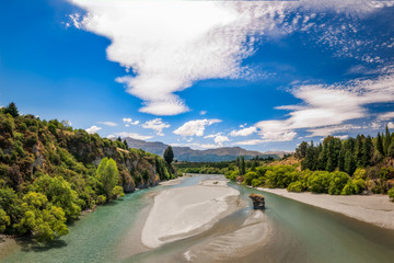 View from the old Bridge towards Coronet and Brow Peaks, over Shotover River, formerly one of the richest gold bearing rivers in the world, Queenstown, New Zealand.