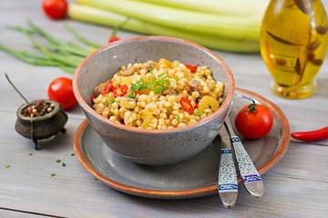 Porridge from Turkish couscous with beef and vegetables. Dietary menu.