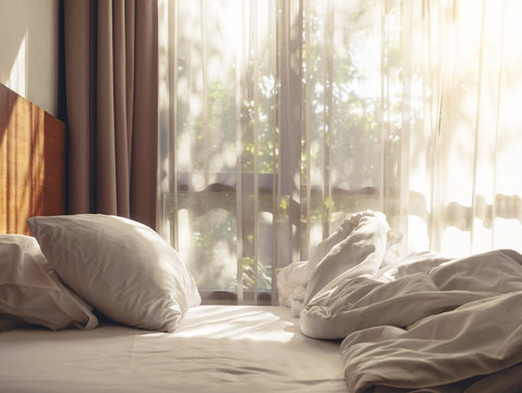 Bed Mattress and Pillows Mess up Bedroom morning sunlight