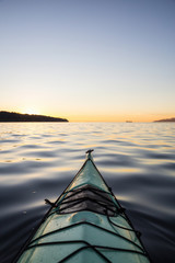 Kayaking during a vibrant Sunset. Taken in Jericho Beach, Vancouver, British Columbia, Canada.