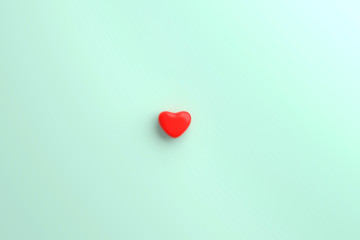 A Little red heart in a middle mint blue background. valentine day concept. minimal style concept