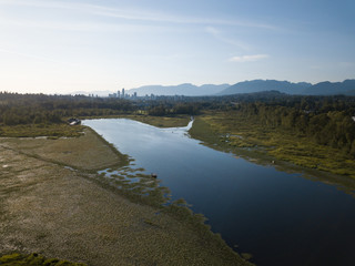 Aerial view of Burnaby Lake during a sunny day in Vancouver, BC, Canada.