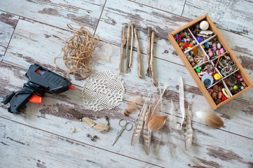 Tools and materials for handicrafts on the wooden floor