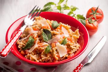 mafalda pasta with tomatoes mint , selective focus