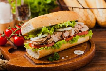 Delicious tuna sandwich, served with lettuce, tomato and onion.