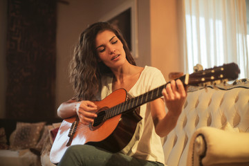 Beautiful woman playing the guitar