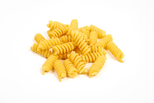 uncooked fusilli pasta noodles isolated on white background