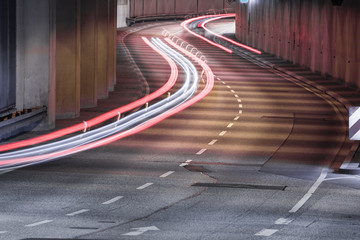 Light trails of cars in the winding tunnel