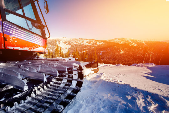 Snowcat trail bulldozer for skiers and snowboarders stands on background of mountains.Freeride snowboarding in Sheregesh ski resort