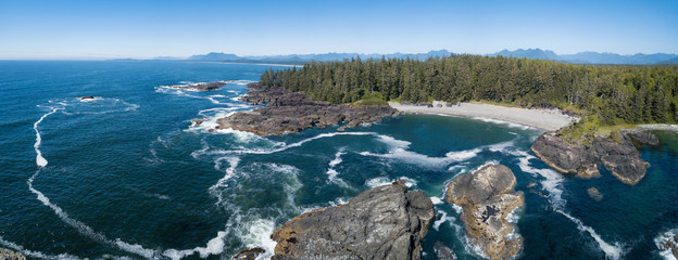 Wall Mural - Aerial panoramic view of the beautiful Pacific Ocean Coast during a vibrant sunny summer day. Taken near Tofino, Vancouver Island, British Columbia, Canada.