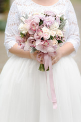 Bride with a beautiful  wedding bouquet