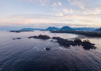 Aerial panoramic view of the beautiful Pacific Ocean Coast during a vibrant summer sunrise. Taken near Tofino, Vancouver Island, British Columbia, Canada.