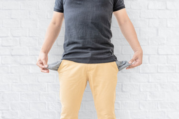Man showing his empty pockets