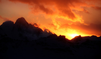 Sunset is seen over the Dolomite Mountains around Cortina D'Ampezzo