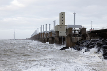 Dutch storm surge barrier closed with closing slides down to prevent flood