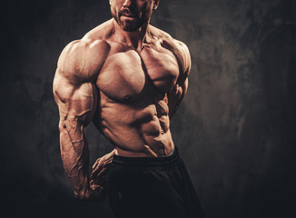 Man showing his muscular body Wall mural