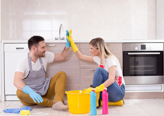 Man and woman happy about finishing chores