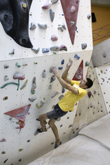 Indoor rock climbing man