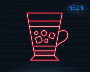 Neon light. Frappe coffee icon. Cold drink sign. Beverage symbol. Glowing graphic design. Brick wall. Vector