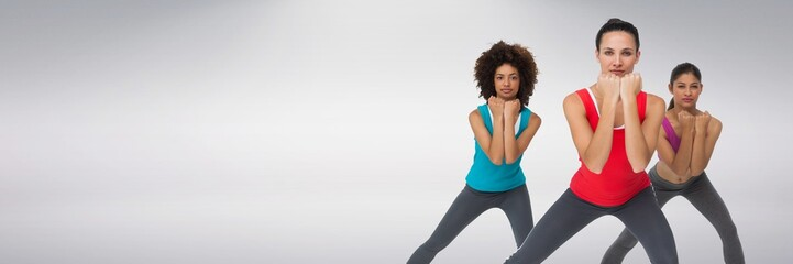 Fit athletic women with grey background doing exercise