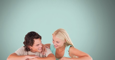 Couple laughing with blue background