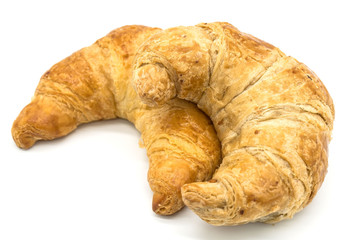 Fresh two croissant isolated on a white background closeup .