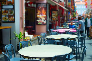 Street restaurant tables. Singapore Chinatown